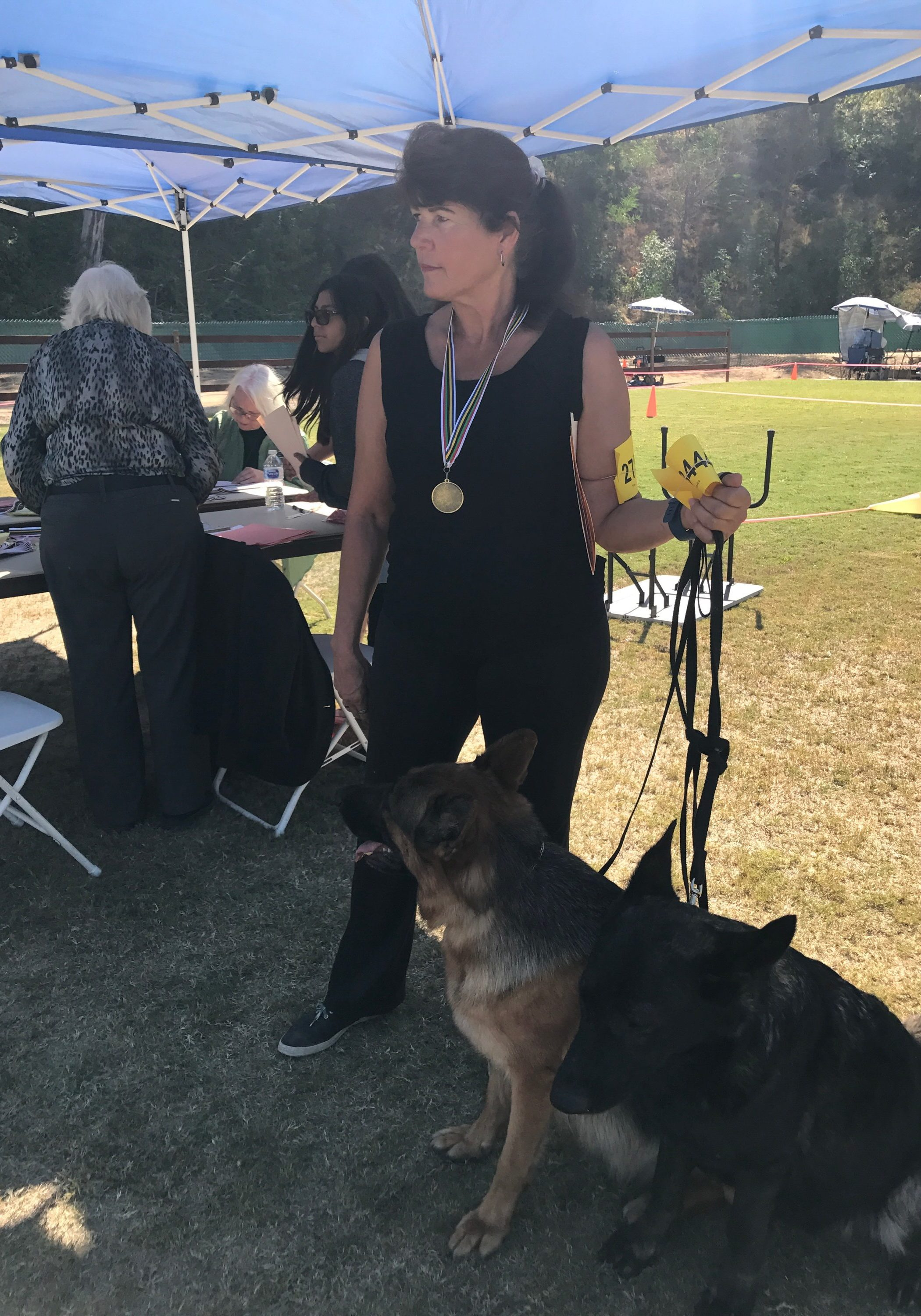 Elaine Moyers with two of her prize-winning German Shepherd Dogs.